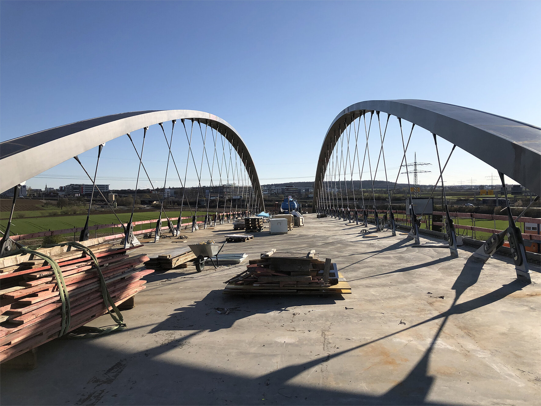 A 127-meter-long railway bridge fully suspended on CFRP hangers
