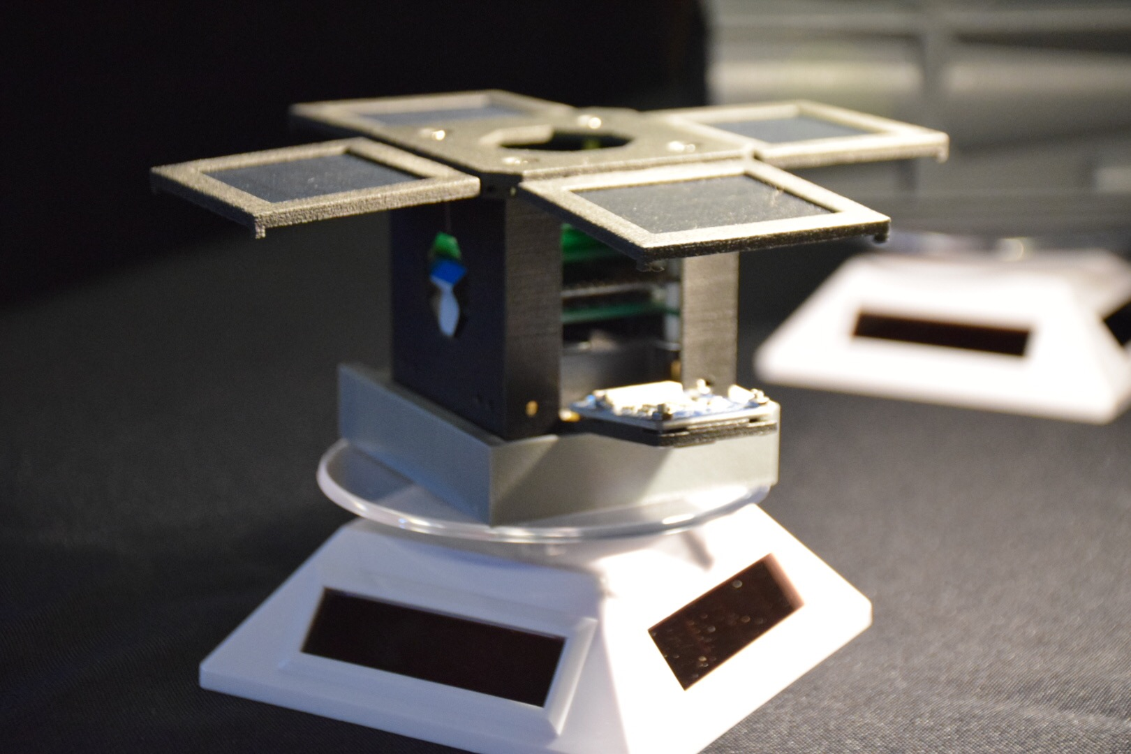 3D printing and the carbon composite for mini satellites - The Discovery 1a engineering model on display at the 3rd PocketQube workshop in Glasgow, Scotland. Courtesy of Mini-Cubes