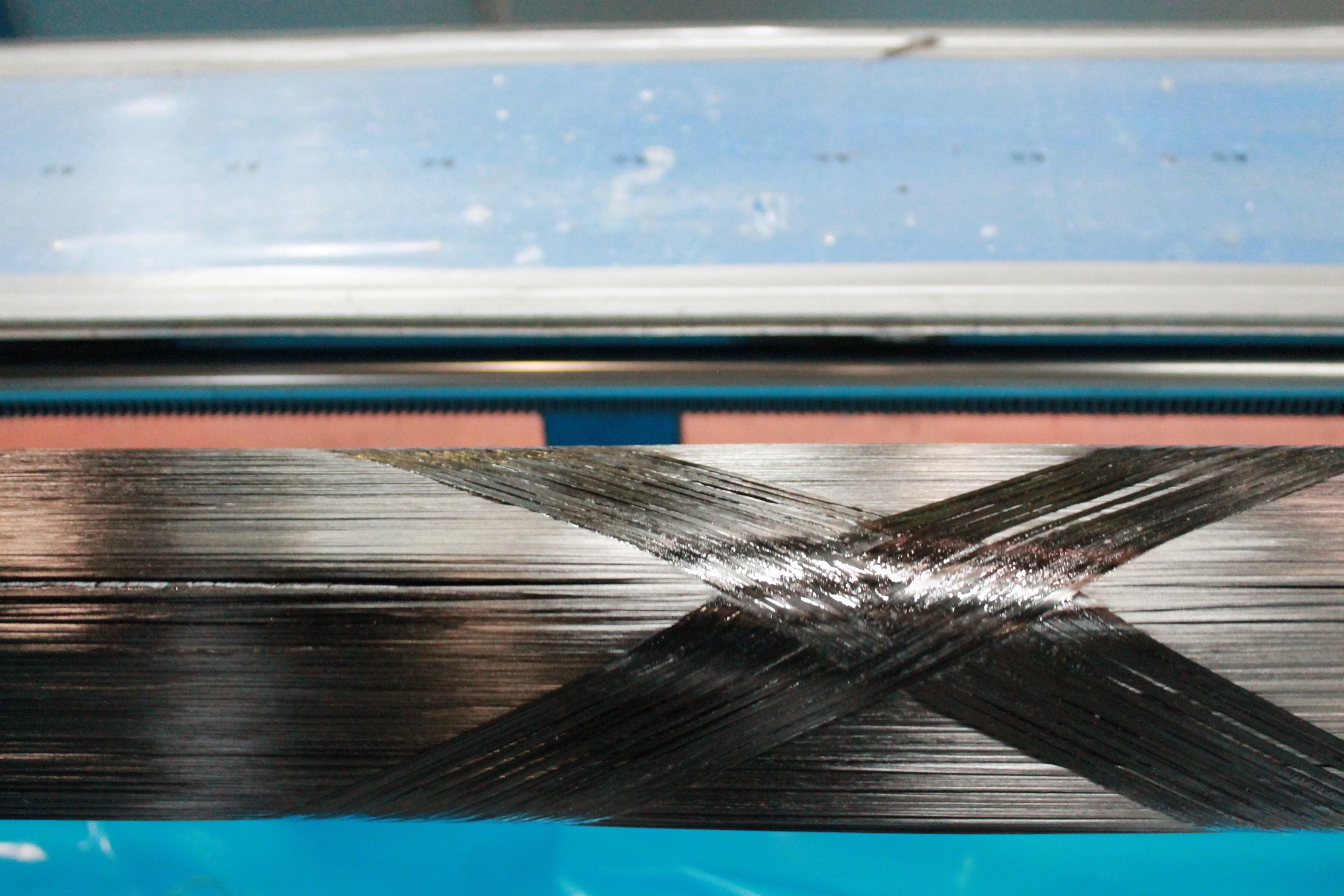 CompoTech winding of a graphite and PAN carbon fibre epoxy square beam.