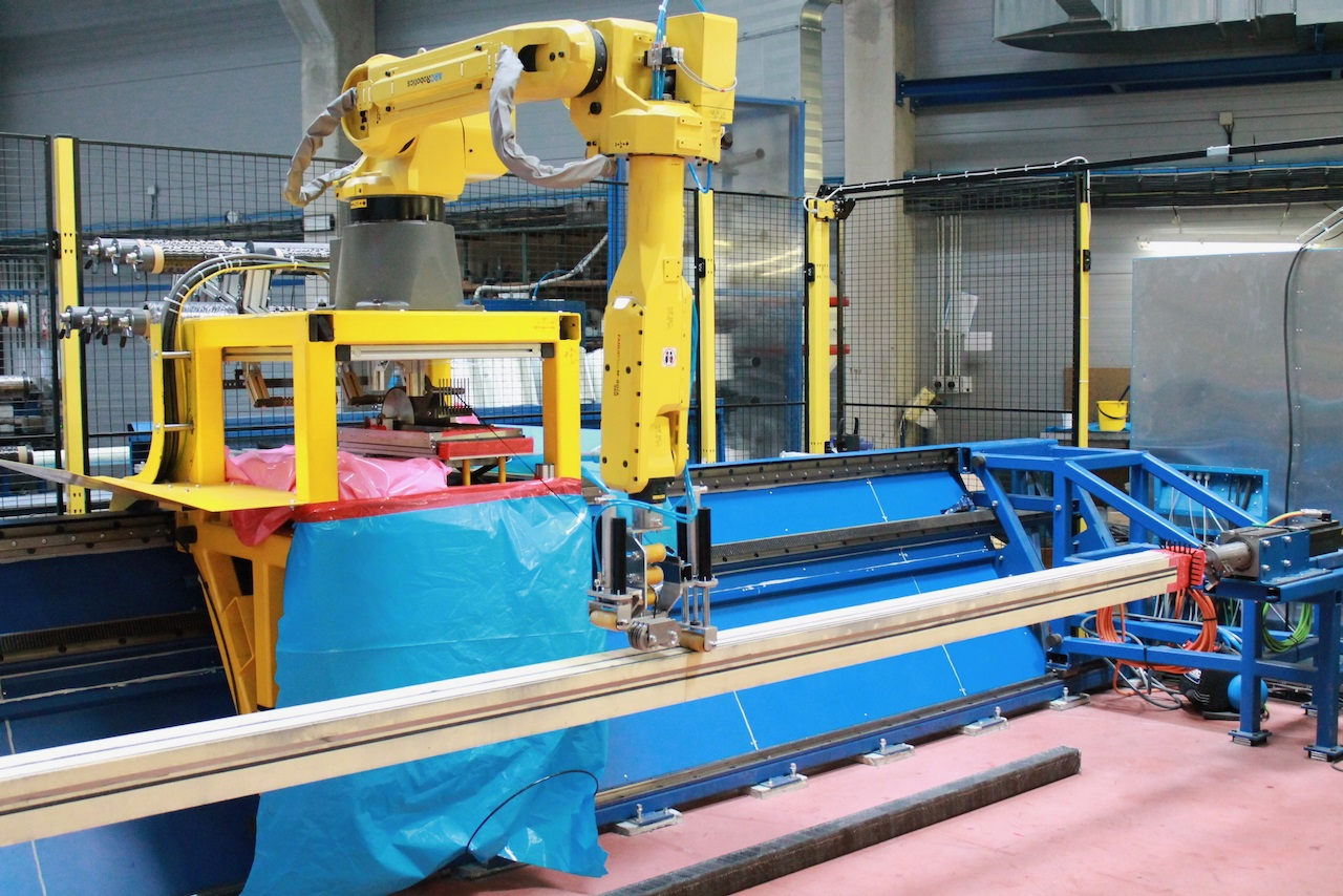 CompoTech robot assisted fibre laying machine producing a square beam.