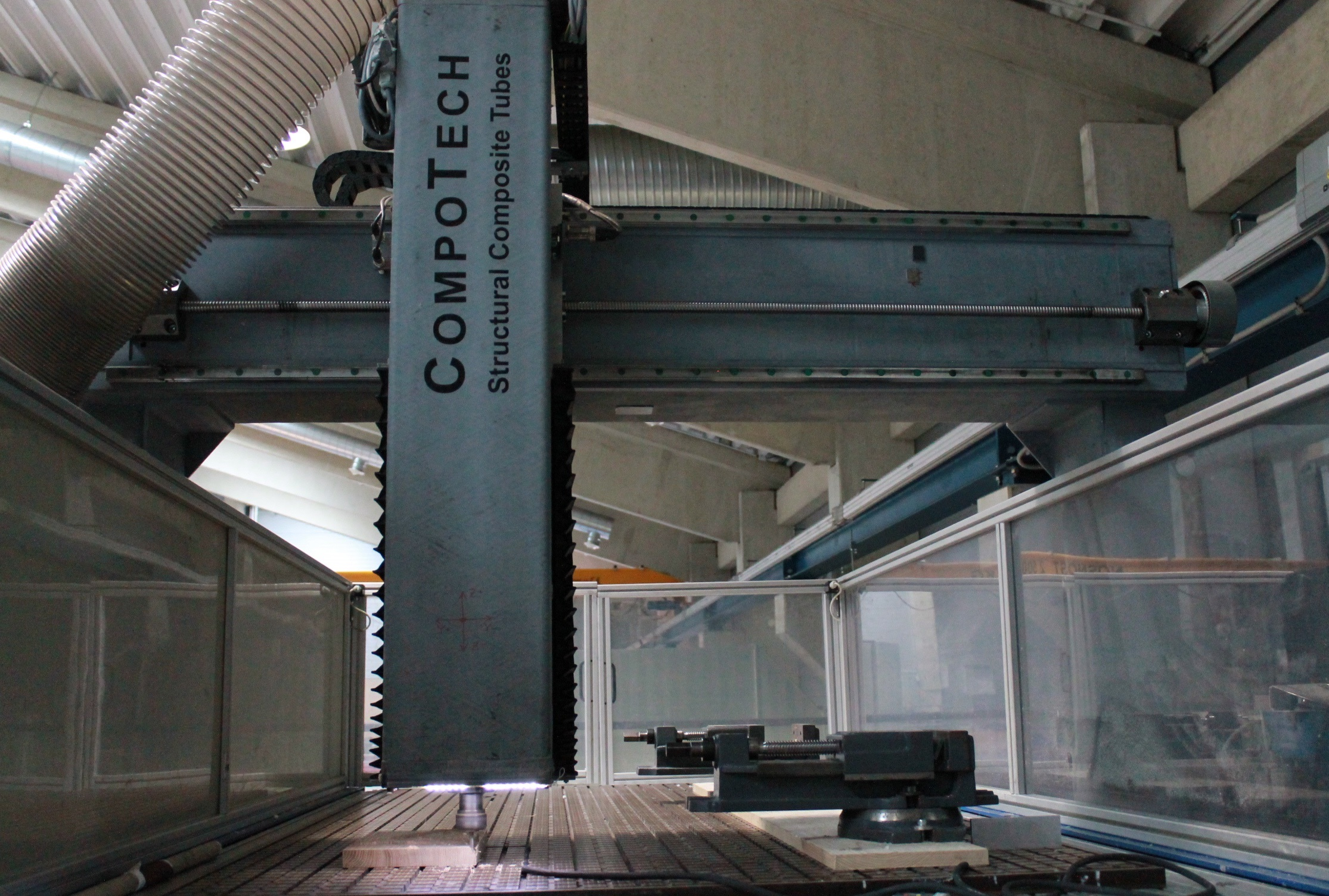 A 3 axis milling machine with CompoTech graphite composite gantry and z axis beams