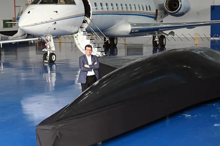 Kelley Aerospace chairman Avraham Kelley posing with a full-sized model of the Arrow at his hangar in Seletar. (Photo: Marcus Mark Ramos)
