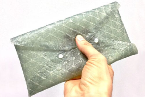 A small clutch purse demonstrates the utility of silk leather in manufacturing products