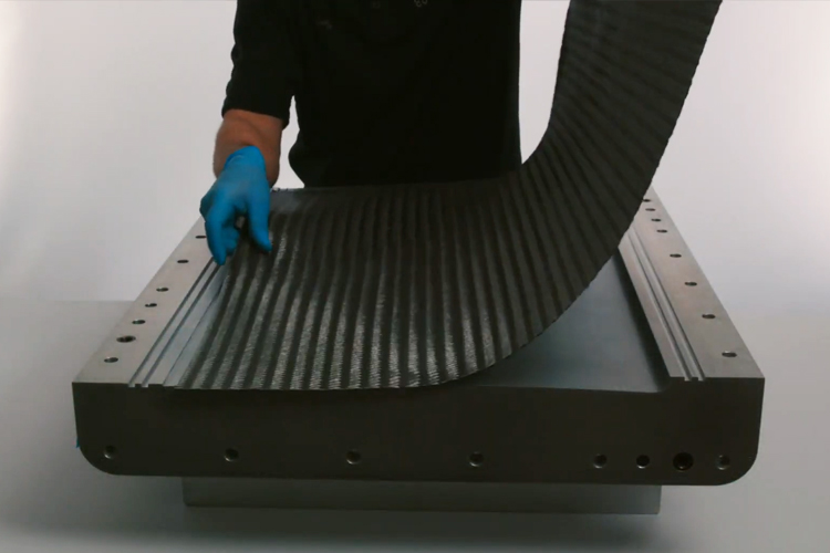 2 layers of quasi-isotropic carbon fiber fabric, called QISO, are laid into the mold to form the lower skin of the control surface.