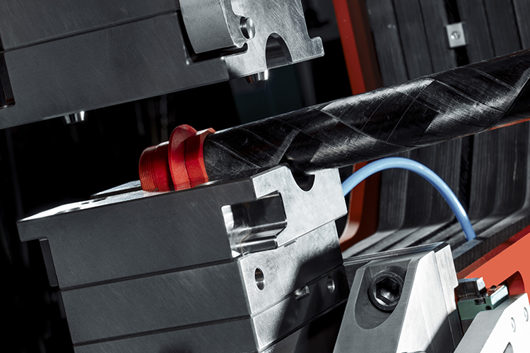 CFRP-based robotised injection moulding machine
