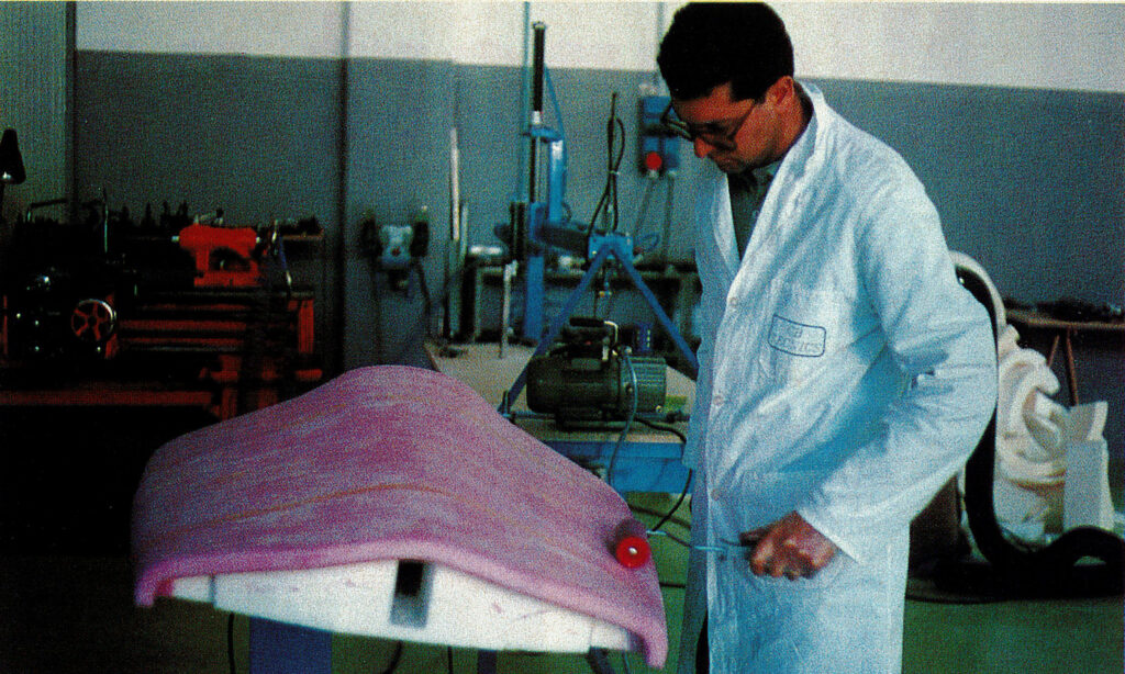One of the first images of Franco  Bercella laminating the first ultra-light composites plane.