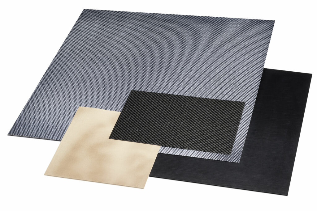 The system enables a wide variety of fibre-reinforced thermoplastic composites to be manufactured efficiently. This includes, for example, organosheets: multilayer, fully impregnated and consolidated fibre-reinforced composites.